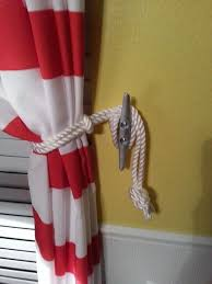 tie backs for nautical shower curtains install a double curtain in the guest and add these for tie backs how perfect