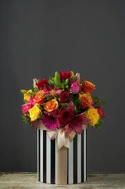 <b>Mix</b> Flowers in Medium Hatbox |with <b>Satin Ribbon</b> | from: R550
