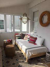 Beach House Porch With Boho Daybed Lots Of Pillows Hanging Jute