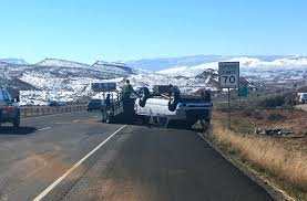 Truck rolls on I-15 after trailer loaded with sand fishtails out of ...