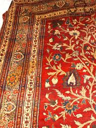 the easiest way to recognize lower end silk rugs is determined by pile height the longer the pile height the er the rug