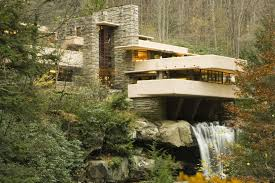 tourists stand on cantilever decks at fallingwater frank lloyd wright s design in pennsylvania