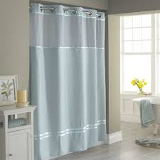 bathroom shower ideas with blue extra long shower curtain liner and wood table plus glass window