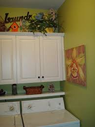 cabinets above washer and dryer. small green laundry room with floating shelf and cabinets, southern hospitality cabinets above washer dryer d