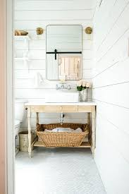 tiny farmhouse bathroom with white shiplap and marble floors