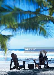 adirondack chairs on beach. Adirondack Chairs On Beach. Perfect Beach Two  Rear View Stock Photo