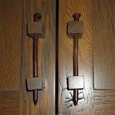 rusty nails and blocks of wood diy handles