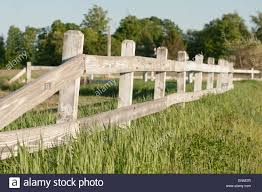 wooden farm fence. An Old, Wooden Fence By A Hay Field On New Hampshire Farm M