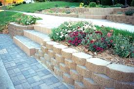 installing retaining wall blocks garden block with stairs build breeze diy how to a retainin