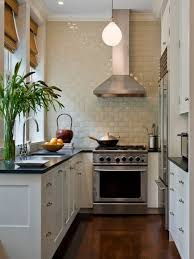 Small transitional kitchen photo in New York with white cabinets and beige  backsplash