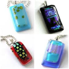 four fused glass pendants