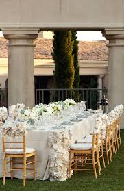 beautiful table idea with lots of flowers gold chairs