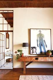 rust red metal crittall windows and glass doors in a farmhouse near cape town south africa credit micky hoyle
