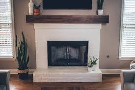 modern white brick fireplace walnut mantel diy