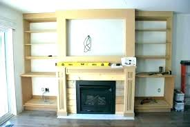 white floating shelves fireplace by