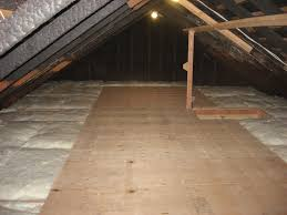 installing a new type of flooring called attic dek