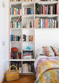view in gallery huge shelving wall until with space for the bed