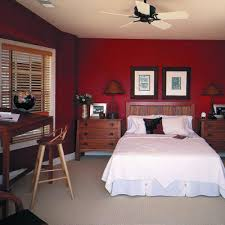 Most wood colors do not look good next to a red wall. This wall color is  making the furniture look bad. I would have kept the red just in the  accents.