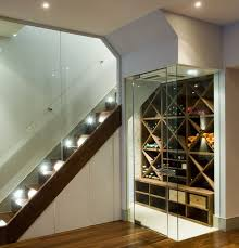 view in gallery contemporary temperature controlled wine room next to the stairs