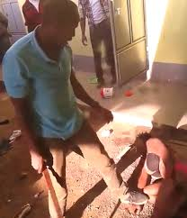 photos neighbours stand and watch as man beats his wife almost to they said the man attacked his wife after catching her another man and no it didn t happen in ia i screen grabbed from the video