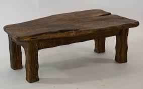handmade chunky dark wooden coffee table by kwetu