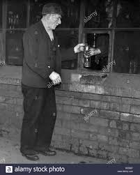 Eighty Years Old Joseph Brogan Collecting His Lamp Prior To Working