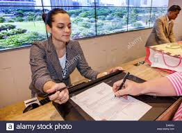 miami florida intercontinental hotel lobby front desk reservations woman employee working job