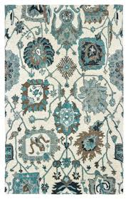 zavier fl tribal ivory blue hand tufted wool area rug mediterranean hall and stair runners by newcastle home