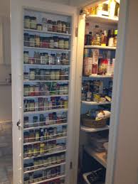 Pantry door spice rack. I hate digging for spices, so my husband built this