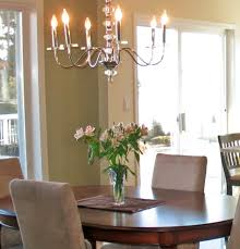 how high should a light fixture hang over a dining room table