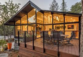 midcentury modern for a contemporary deck with a wall of windowid century modern