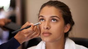 model having concealer applied to her undereyes
