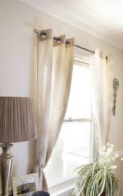 diy curtain rod using cabinet s and a dowel rod