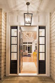 the front entry lighting is a um darlana lantern from circa lighting