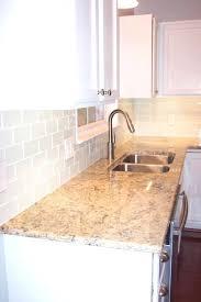 white glass subway tile kitchen traditional backsplash cabinets with