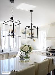 Bright And Airy Kitchen With Two Tone Lantern Style Pendant Lighting Over  The Island.