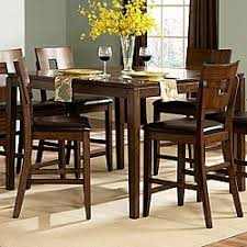 this contemporary dining room furniture from the fabulous watson counter height collection will add style to your home decor this dining set contains a