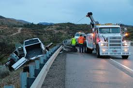 Pickup pulling trailer plows through guardrail in early morning I-15 ...