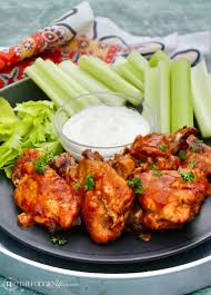 instant pot en wings on a black plate with celery and blue cheese dressing instantpot