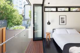 441 project trendy bedroom photo in sydney with white walls black bedroom furniture hint