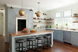 blue beadboard kitchen island with arteriors osgood iron pendants