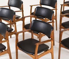 large set of 11 danish armchairs in teak and original black upholstery 2