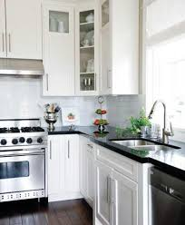 black countertops and white cabinets