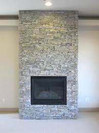 stacked stone fireplace with marble hearth