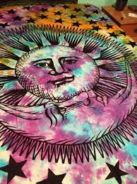 100% hand loomed cotton tapestry with a colorful tie dyed background and a  black Sun
