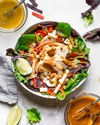 grilled chicken salad.  Salad Grilled Chicken Salad With Greens And Vegetables Are Tossed In A Honeylime  Vinaigrette In