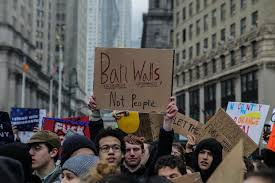 high student of nyc are protesting following cur political shift of usa that ave been affecting muslim and immigrant students at foley square