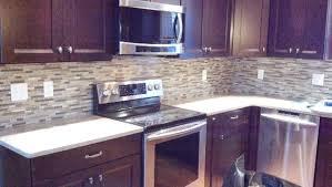 kitchen backsplashes with cherry cabinets. cherry cabinets mosaic backsplash traditional-kitchen kitchen backsplashes with t