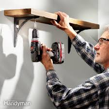 hang shelf on concrete wall without drilling design ideas