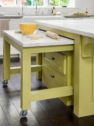 a pull out table on wheels can make a kitchen island even more functional  than it